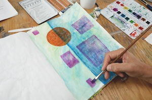 Step 4: Add more watercolor and continue layering.