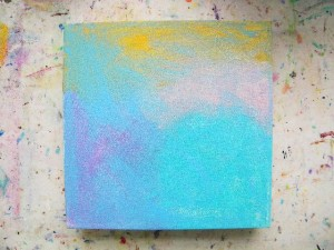 Gather your materials. If you don't have all the things I listed, use what you have. Get rid of the blank page by spreading some paints across the canvas with a paper towel or baby wipe. Since it's an outdoor scene, make part of the canvas a sky. Don't think about it too hard, just spread some paint around quickly and let dry.