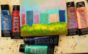 Paint the house shapes with assorted acrylic paints. Let dry.