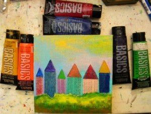 Paint the rooftops with different acrylic colors.