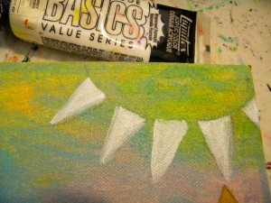 . Paint the flags white with acrylic paint and let dry.