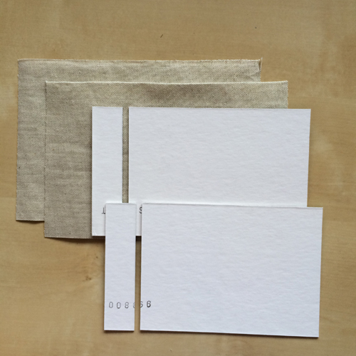 """Start by cutting your book covers and the book cloth (or paper) you're going to cover them in. For this type of binding, cut 1"""" (3cm) off of one side of each cover but don't discard it."""